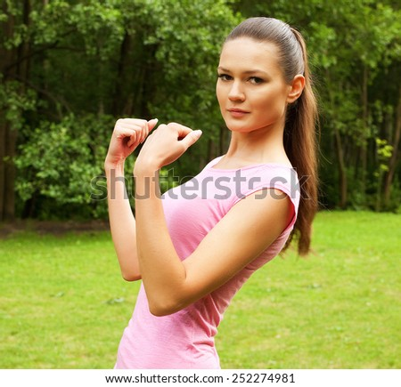 Young woman doing sports outdoors. Sport and lifestyle concept. - stock photo