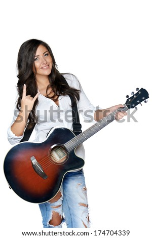 Young woman doing the 'devil's horns' hand gesture - stock photo