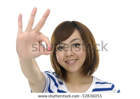 Young woman doing the ok sign