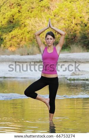 Young woman doing yoga. - stock photo