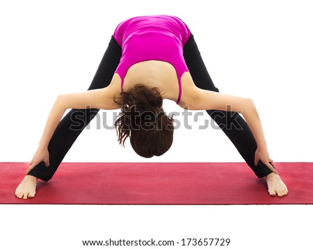 Young woman doing yoga and pilates  (Series with the same model available) - stock photo