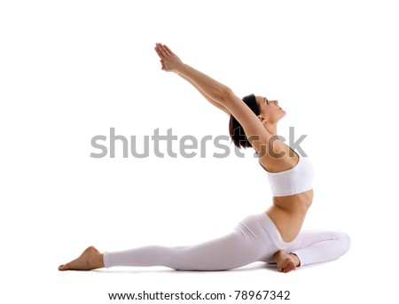 Young woman doing yoga asana - pigeon pose - stock photo