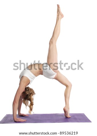 Young woman doing yoga exercise - stock photo