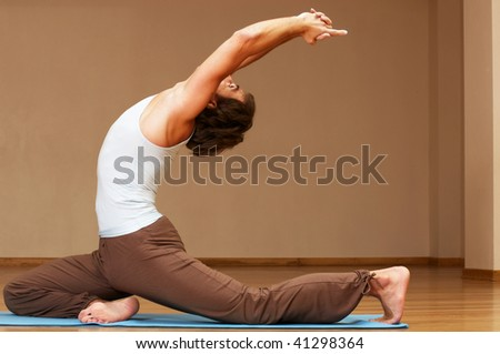young woman doing yoga exercise indoors