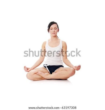 Young woman doing yoga exercise , isolated on white - stock photo