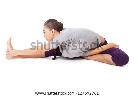 Young woman doing yoga exercise isolated on white background