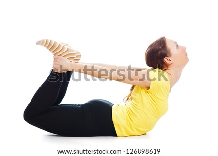 Young woman doing yoga exercise on a white background.