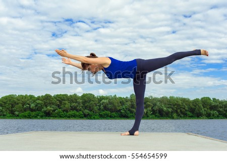 Young woman doing yoga exercise on mat 20