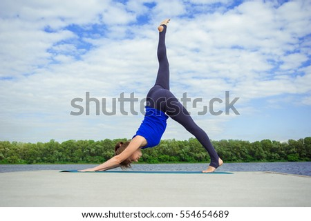 Young woman doing yoga exercise on mat 08