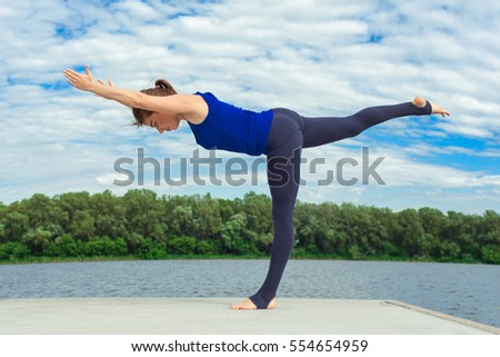 Young woman doing yoga exercise on mat 19