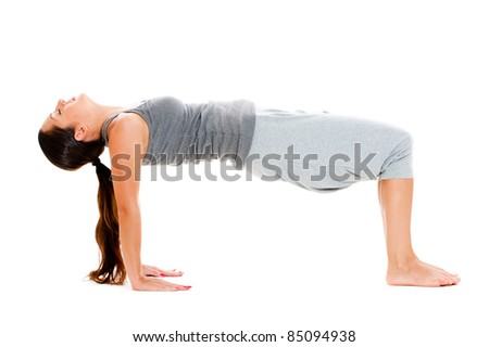 young woman doing yoga exercise over white background - stock photo