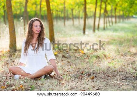 Young Woman doing Yoga Exercises - stock photo