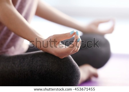 Young woman doing yoga in gym