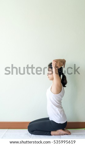 young woman doing yoga, indoor sport