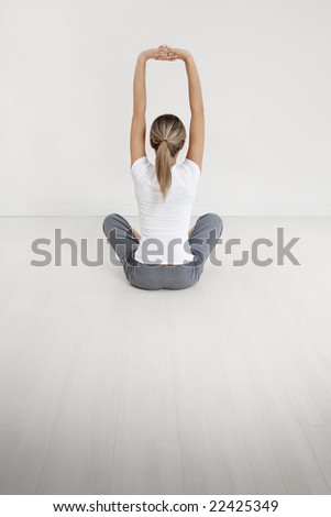 young woman doing yoga indoors. Copy space - stock photo
