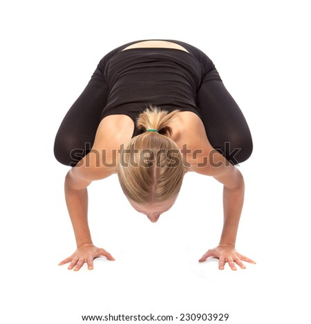 Young woman doing yoga on a white background