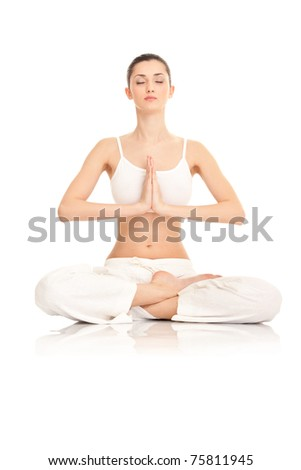 young  woman doing yoga  on white background - stock photo