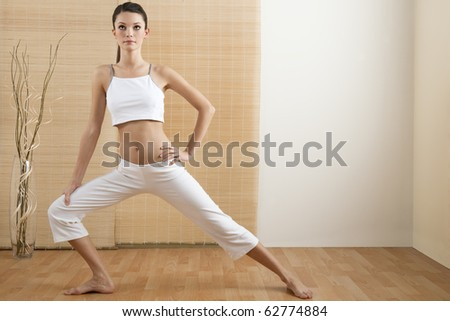 Young woman doing yoga or stretching - stock photo