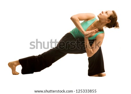 Young woman doing yoga pose .Isolated on white - stock photo