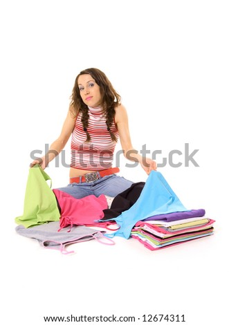 young woman don't know what t-shirt to wear