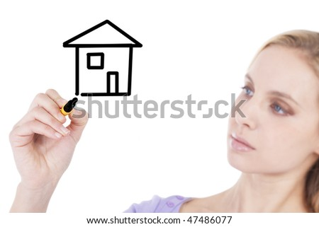 Young woman drawing a house  on copy space; concepts: wishing a new house