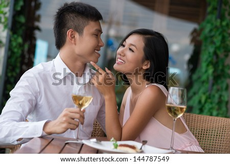 Young woman drawing attention of her boyfriend with a tender touch