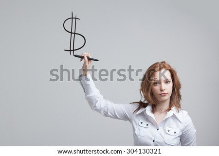 Young woman drawing dollar symbol on grey background