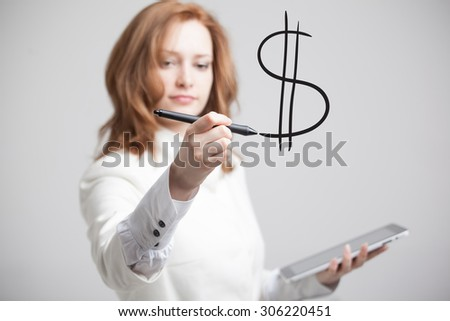 Young woman drawing dollar symbol on grey background - stock photo
