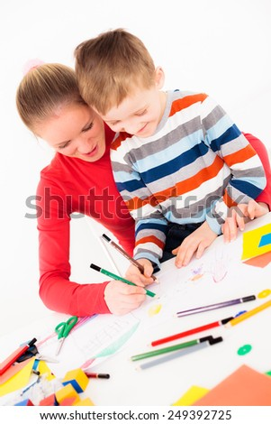 Young woman drawing picture with her child