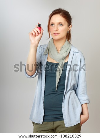 Young woman drawing something, copyspace for the designer - stock photo