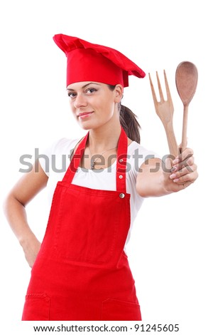 young woman dressed as a cook with cap over white backgound - stock photo