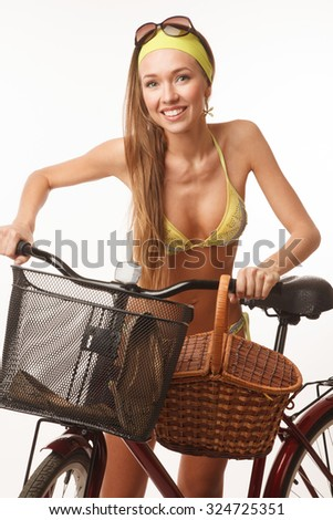 Young woman, dressed in bikini, with bicycle
