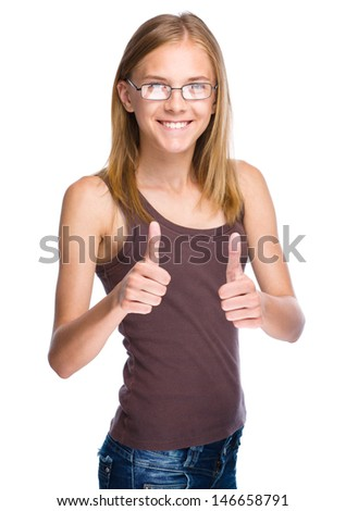 Young woman dressed in blue is showing thumb up gesture using both hands, isolated over white - stock photo