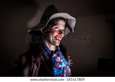 Young woman dressed in fancy-dress as a witch - stock photo