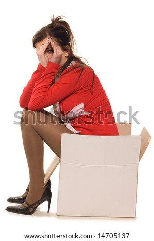 Young woman dressed in red clothes sitting on cardboard box