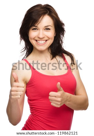 Young woman dressed in red showing thumb up gesture using both hands, isolated over white - stock photo