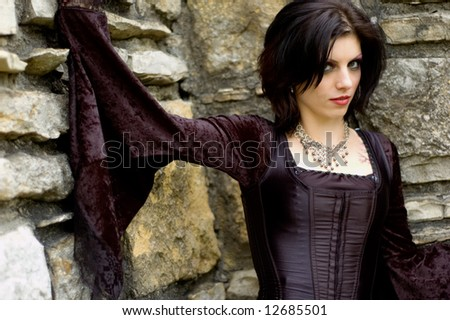 Young woman dressed in wicked goth clothing