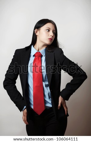 young woman dressed up in a man suit and tie - stock photo