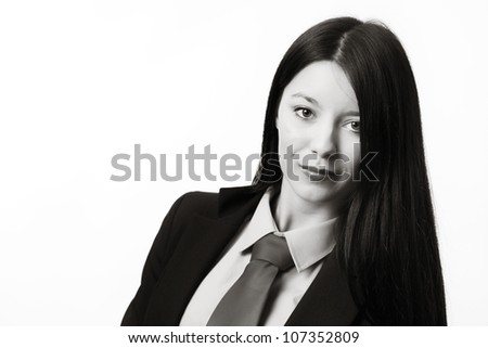 young woman dressed up in a man suit and tie looking at camera - stock photo