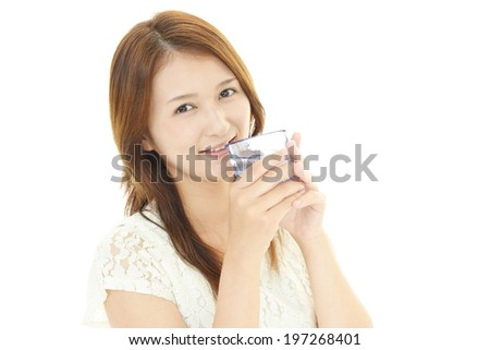 young woman drinking a glass of water
