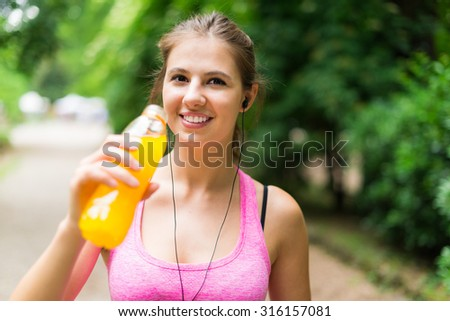 Young woman drinking after sport - stock photo