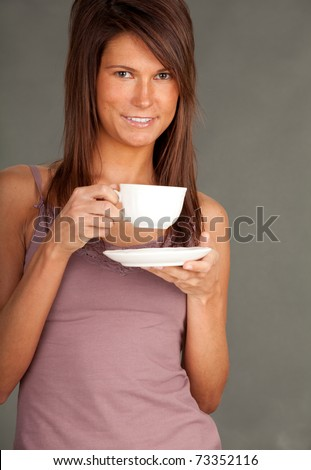 young woman drinking coffee, grey background, series