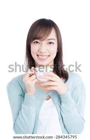 young woman drinking coffee isolated on white background
