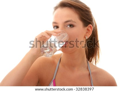Young woman drinking fresh cold water from glass - isolated on white - stock photo
