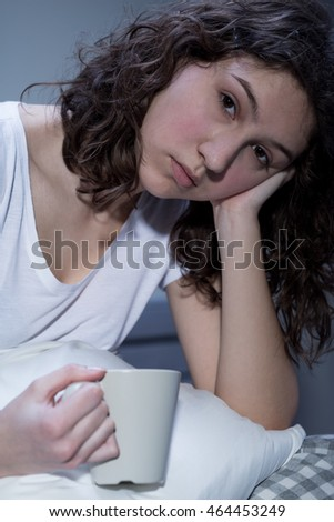 Young woman drinking hot chocolate has sleep disorder
