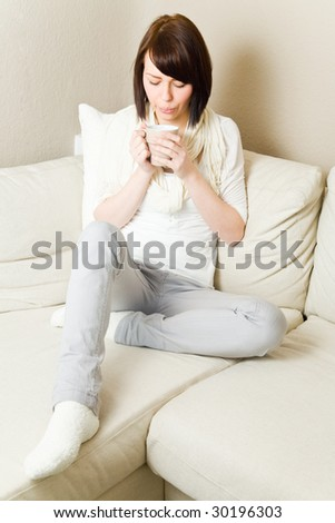 Young woman drinking hot coffee - stock photo