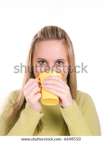 young woman drinking hot tea