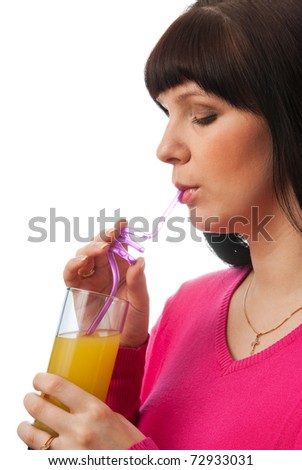 Young woman drinking juice with straw isolated on white