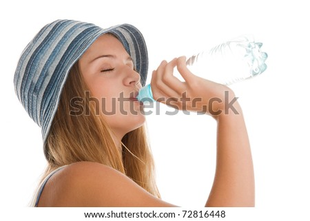 Young woman drinking mineral water - stock photo