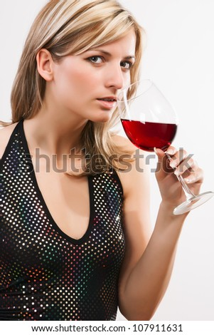Young woman drinking red wine - white background - stock photo